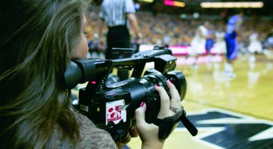 Student Capturing Video at MU Basketball Game