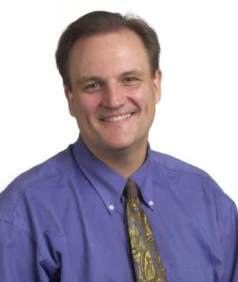 John Mark Eberhart, BJ '83