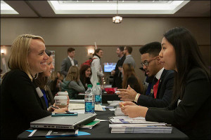 Terry Hoffman, senior vice president at FleishmanHillard, smiles while chatting with students. FleishmanHillard is headquartered in St. Louis and has more than 80 offices worldwide.