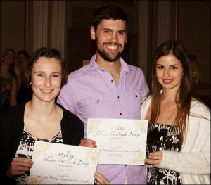 From left, Jordan Huss, Tucker Moore and Melina Loggia of therAdZou team pose after a first-place winin the AdZou Plan Book Design category.
