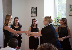 DASS Director Jill Findeis congratulates Account Executive Lauren Rundquist and her teammates Abby Gray, Jamie Beard and Amy Silvestri on their campaign presentation.