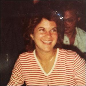 Janice (Kalmar) McDill, BJ '82, smiles for a photograph as an undergraduate.