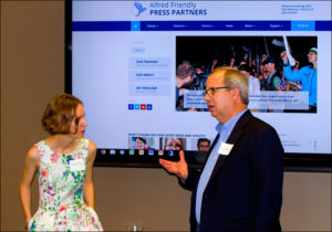 Donald W. Reynolds Endowed Chair in Business Journalism Randy Smith talks with 2016 fellow Olena Goncharova from Ukraine.