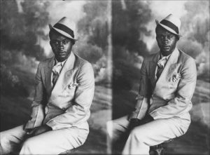 Man in double-breasted suit and hat. From a 5x7 glass plate, split-back negative, circa 1925.