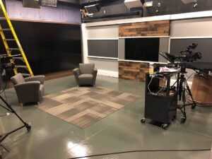 "The new set takes up all but 10 percent of the studio's available wall space and includes a large video wall on the west wall and a 65"" inch TV on the north wall."