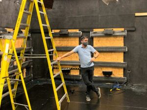 Senior Media Producer Travis McMillen surveys the construction of the new set in the studio at RJI.