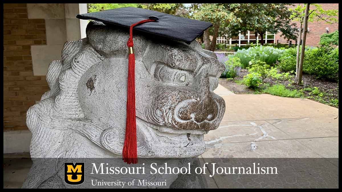Journalism arch lion wearing mortar board and tassel.