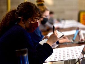 Senior Sara Dingmann takes handwritten notes May 5 in the media gallery of the Missouri House of Representatives.