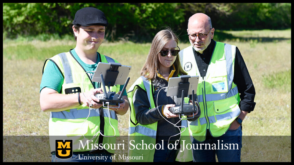 Junior Jake Young, left, and senior Grace Vance, center, operate an Inspire 2 drone near The Big Tree on May 12, 2021. The two took turns flying and taking photos and video. Looking over Vance's shoulder is Professor Stacey Woelfel. Photo by Nate Brown | copyright: 2021 - Curators of the University of Missouri